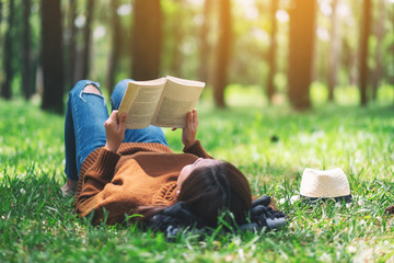 Girl reading book and showing her interest.